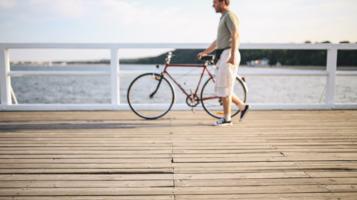 kaboompics_Man with bicycle.jpg